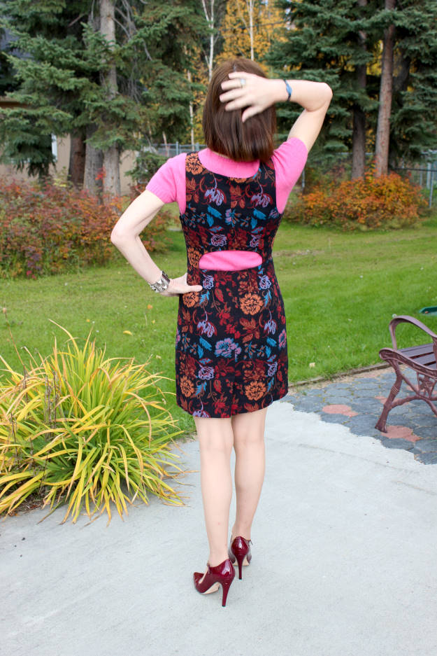 fashion blogger in chic work appropriate cutout dress