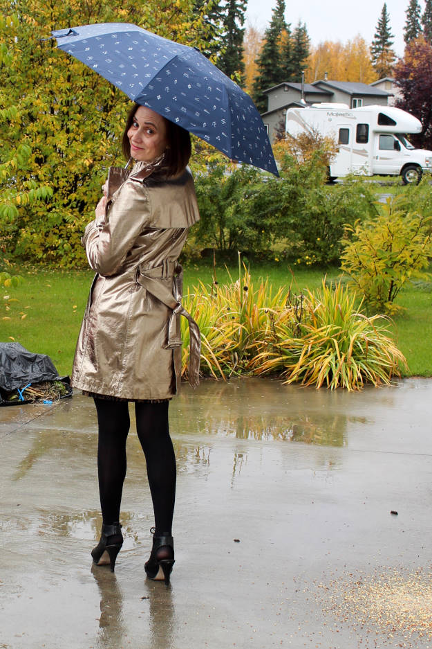 fashionover40 Woman in a golden trench coat on a rainy day