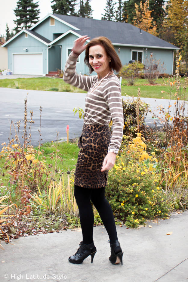 #fashionover50 blogger in sweater and pencil skirt with different patterns