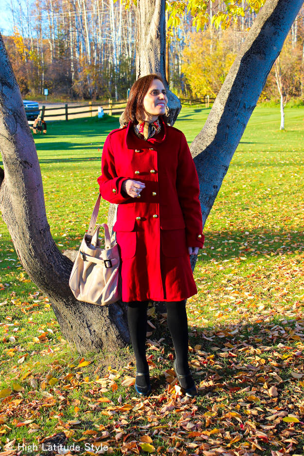 #fashionover50 mature woman in red pea coat