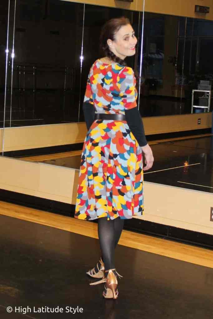 stylist in fit-and-flare dress with tights and sandals