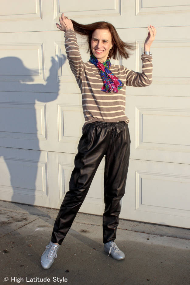 fashion blogger over 40 in joggers with striped sweater