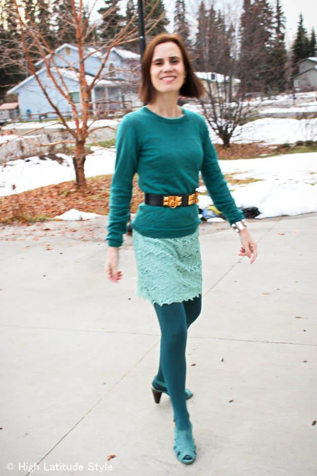 mature woman in monochromatic work outfit
