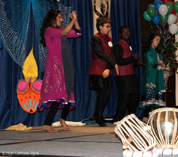 Young people dancing to celebrate the holiday of light