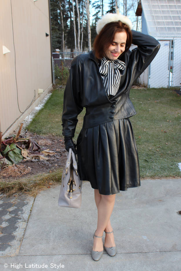 mature woman in leather skirt and jacket