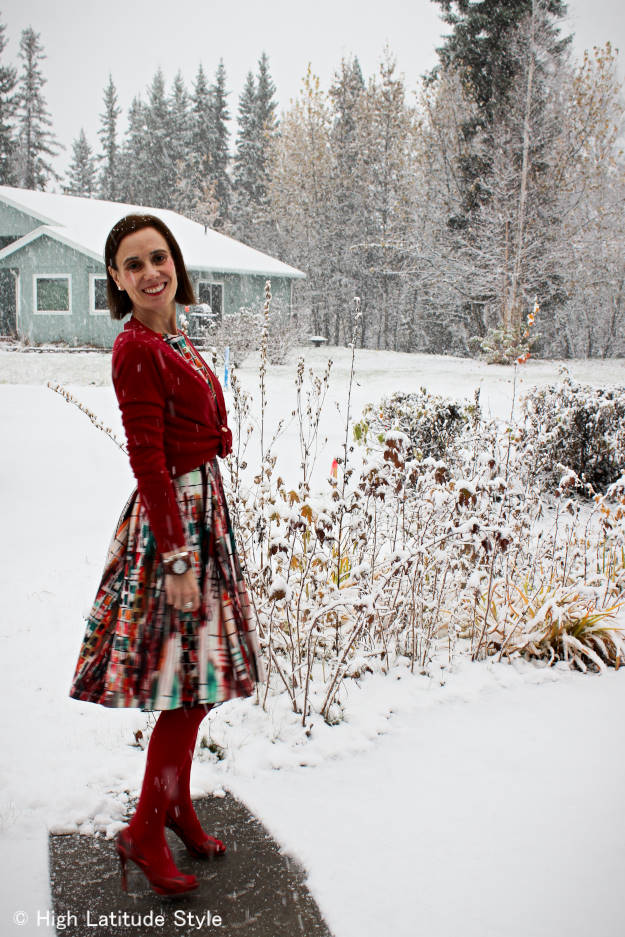 over 50 years old fashion blogger wearing a summer dress styled for the first snow in October