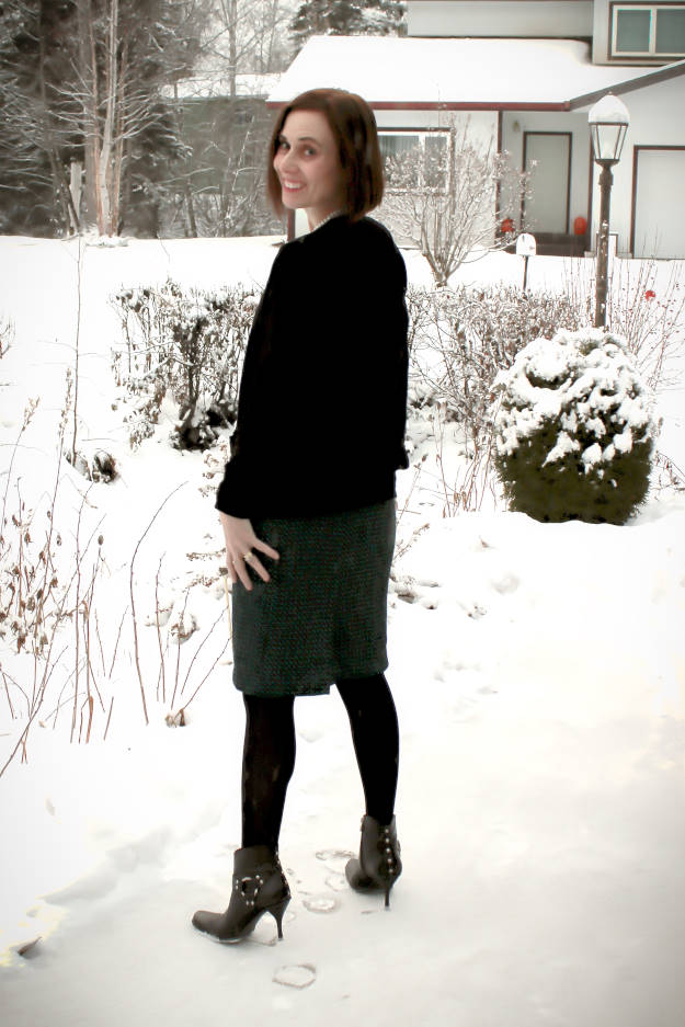 #fashionover40 woman in work outfit with skirt, cardigan and booties