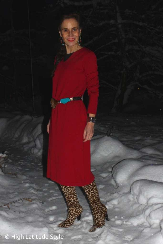 over 50 years old Alaskan woman in a little red dress with tall boots