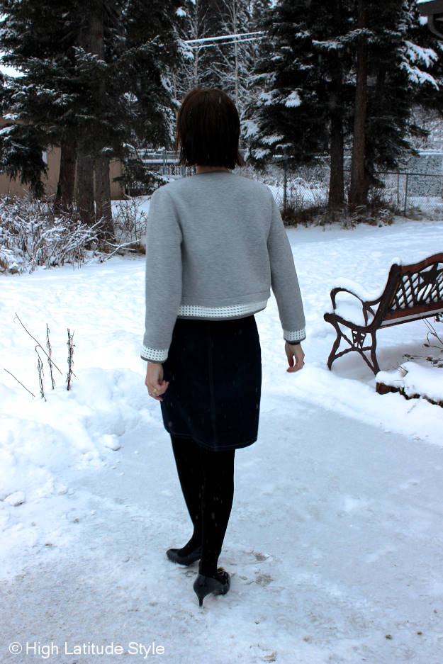 Alaskan blogger with denim skirt, wool sweater, cropped jacket