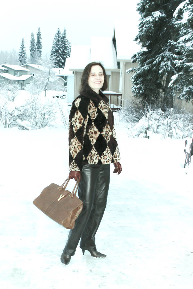 50 plus woman wearing leather pants and outerwear