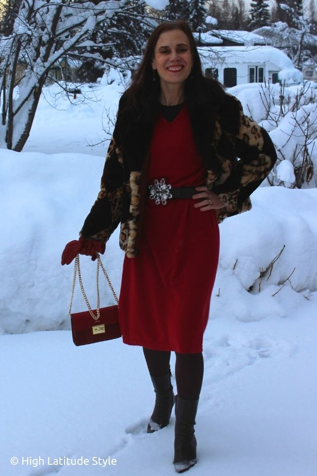 stylist in red knit dress and bag with brown tights, booties, belt and short jacket with leopard print