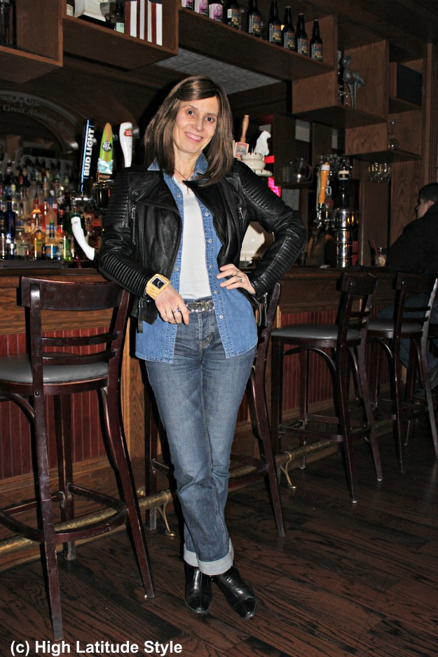 fashion blogger over 50 in posh casual in denim-on-denim with leather