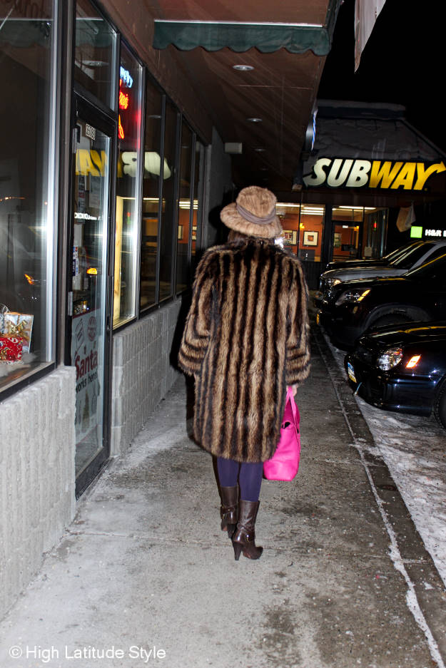 over 50 fashion blogger walking in a mall in Alaska in winter at Christmas time