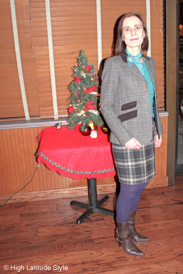 style blogger in mature winter work outfit with plaid blazer and sheath