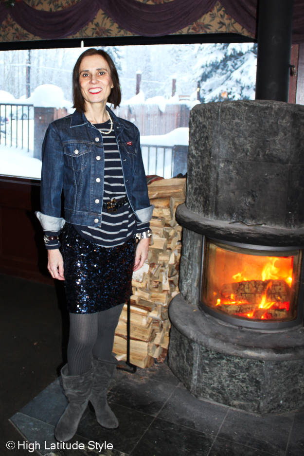 #over50fashion midlife woman in a chic a sequin skirt with denim jacket