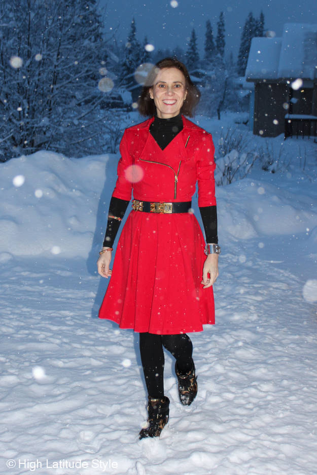 style book author in little red dress with black tights