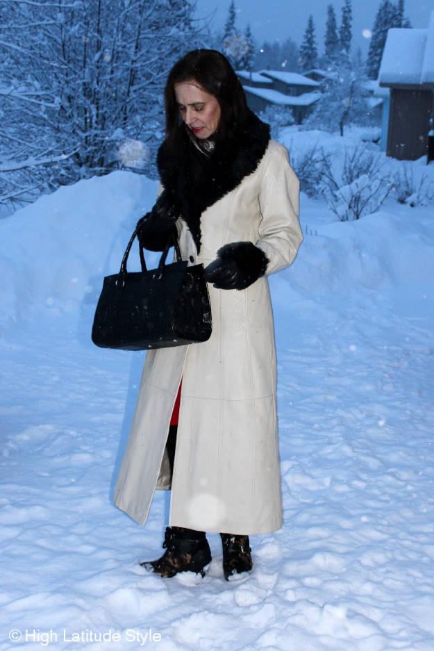 #maturefashion woman in tea length leather coat with faux fur trim