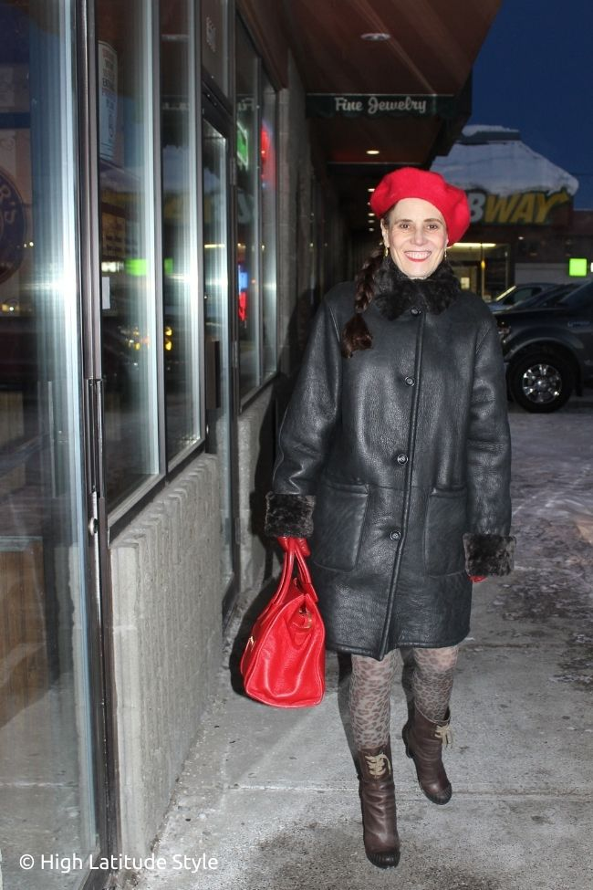 over 50 years old fashion blogger in all neutrals outerwear with a pop of red