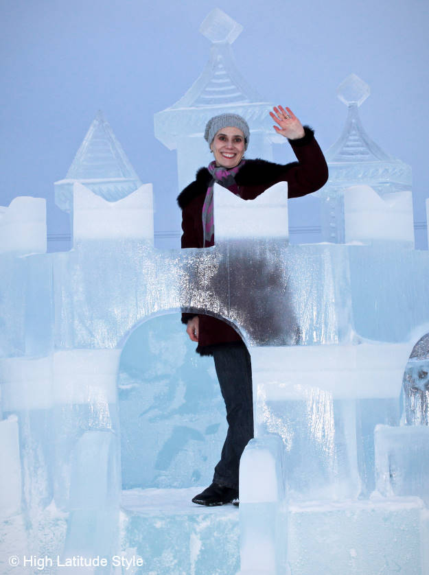 Alaskan blogger at the Ice Classics Championship waving from Cinderella's castle carved from frozen water