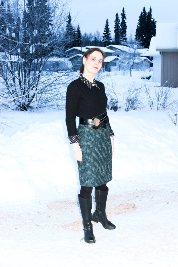 #fashionover40 winter work outfit with tall black boots, skirt, and polka dot shirt