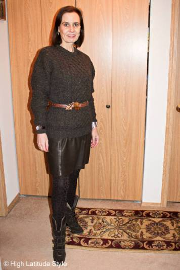 Winter outfit with Irish cable-knit sweater, Eli Tahari leather dress, Kieselstein Cord belt and buckle, tight, Soeft shearling booties (all own) with wooden watch c/o Jord