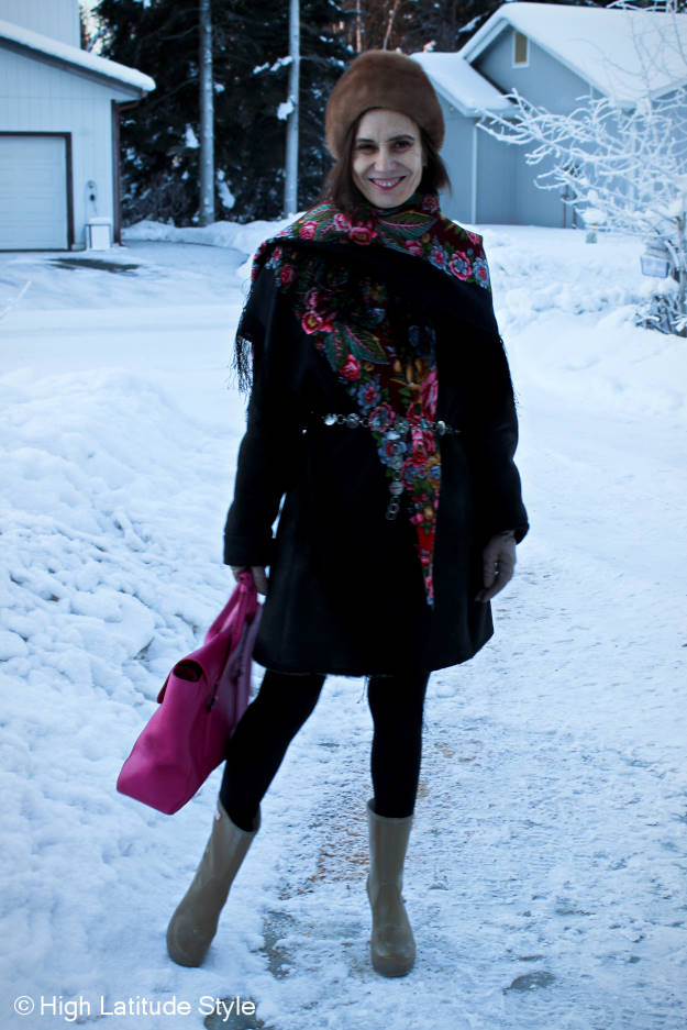 style blogger showing a shearling coat accessorized with a Russian scarf for a different look