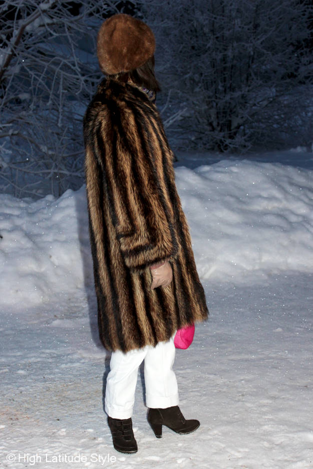 over 50 years old stylist in white boyfriends and fur coat in winter