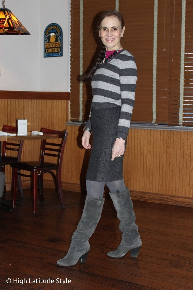 fashion blooger in light and drak gray top, pink top, tweed skirt, tights