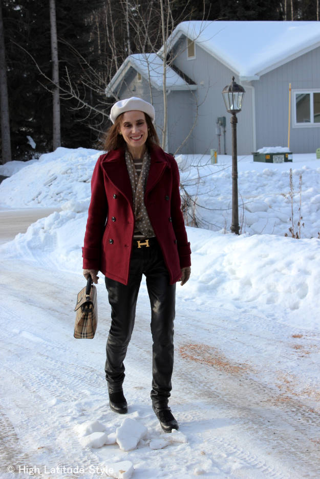 #fashionover50 woman in classic burgundy peacoat styled in a Euro Chic way