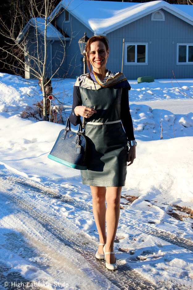 mature work outfit with leather sheath dress