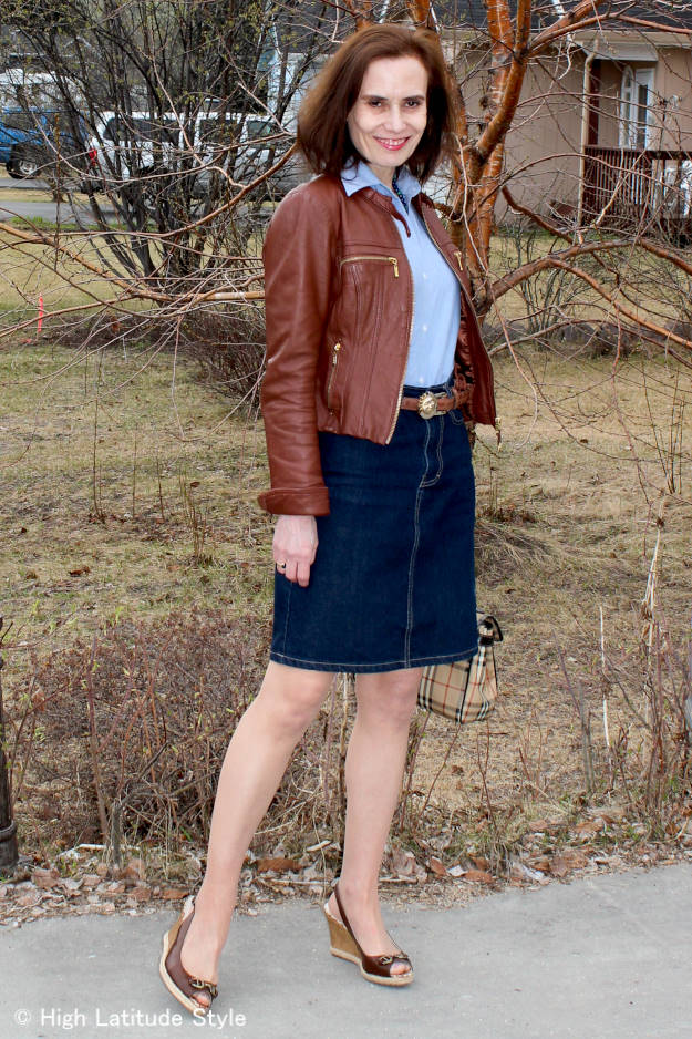 details of a fashionable casual work outfit with leather jacket