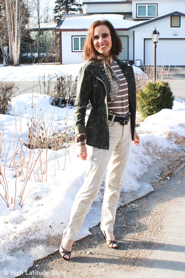Alaskan woman in casual spring outfit with military outerwear