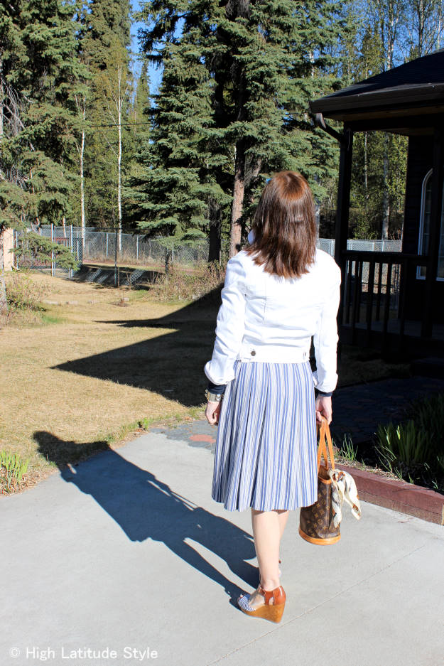 mature style blogger in a BBQ outfit with denim jacket and dress