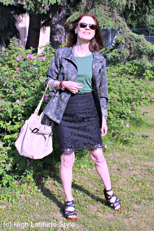 mature woman in lace pencil skirt with utility jacket