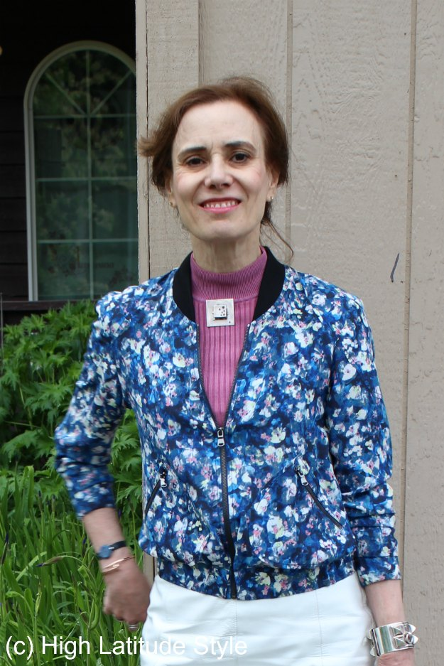 floral bomber styled with pink mock neck sweater and DIY brooch