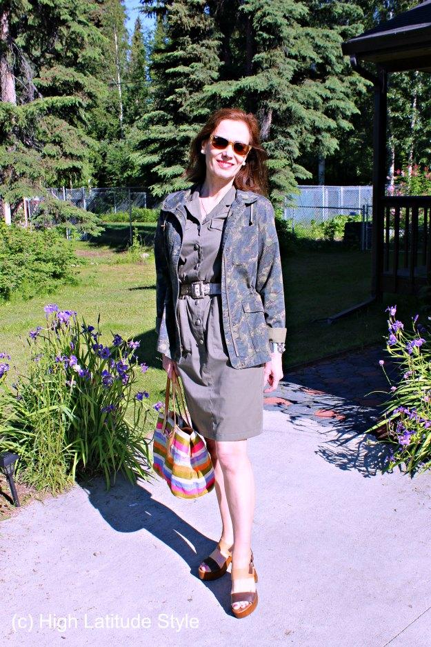 midlife blogger in urban safari look of dress, sandals, sunglasses