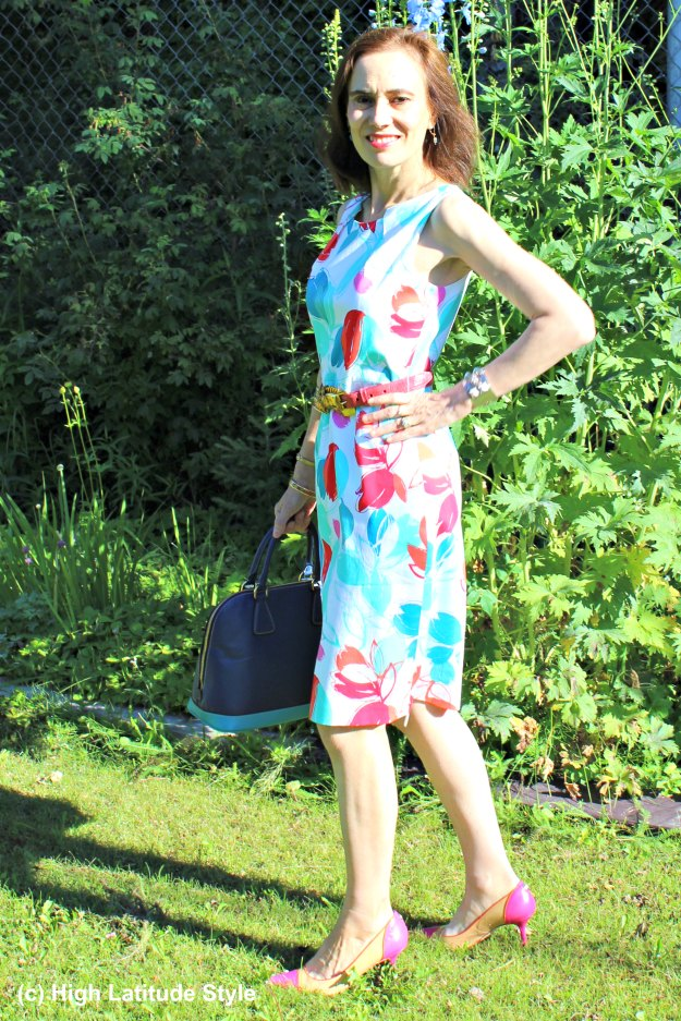 mature woman in is an abtract floral print sheath