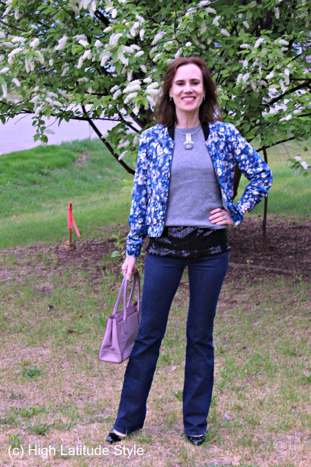#styleover40 weekend outfit with floral bomber, sequin top and flared jeans