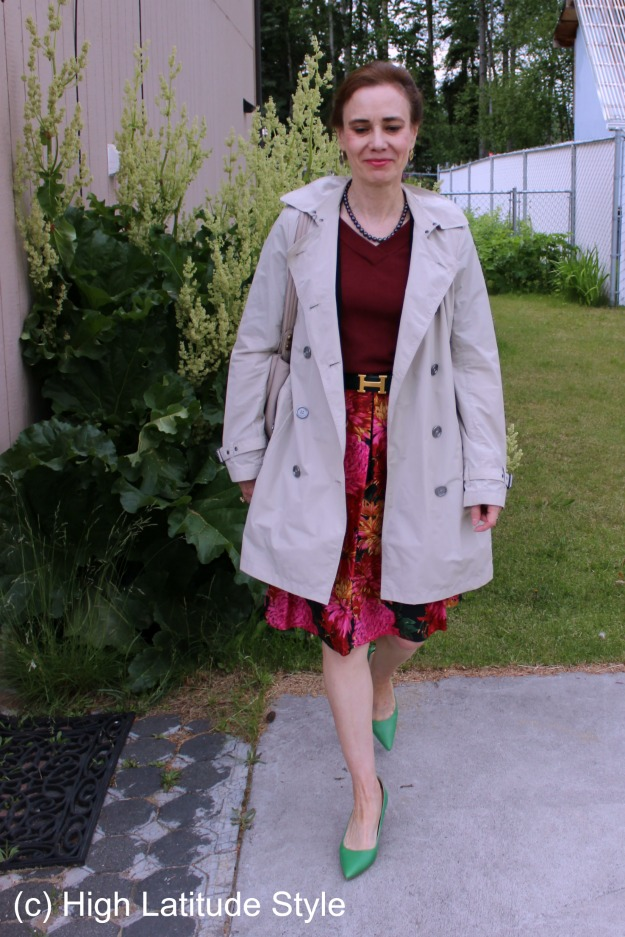 fashion over 50 mature woman in floral skirt and trench coat