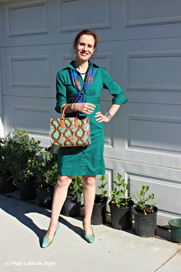 #fashionover40 mature woman looking stylish in a teal shirt dress