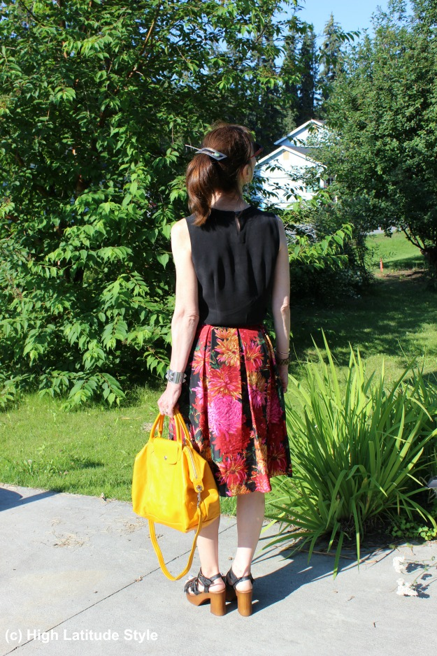 Stylist in summer skirt and black top