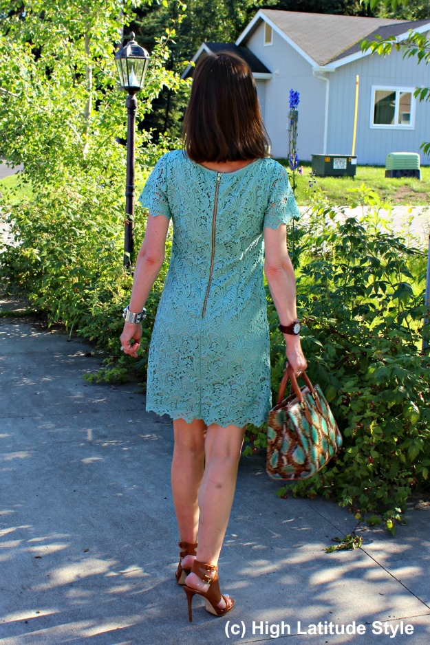 posh chic midlife woman in shape giving lace dress and sandals