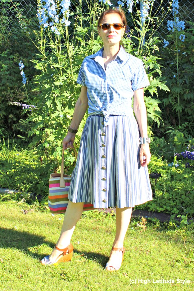 mature style blogger in blue and white skirt and shirt