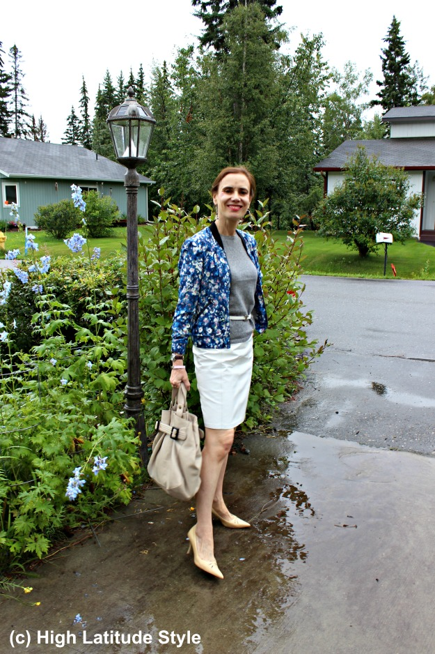 #fashionover40 mature woman in casual work outfit with leather skirt and floral bomber