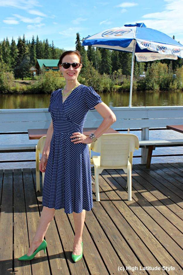 fashion book author in classic navy-white polka dress for work