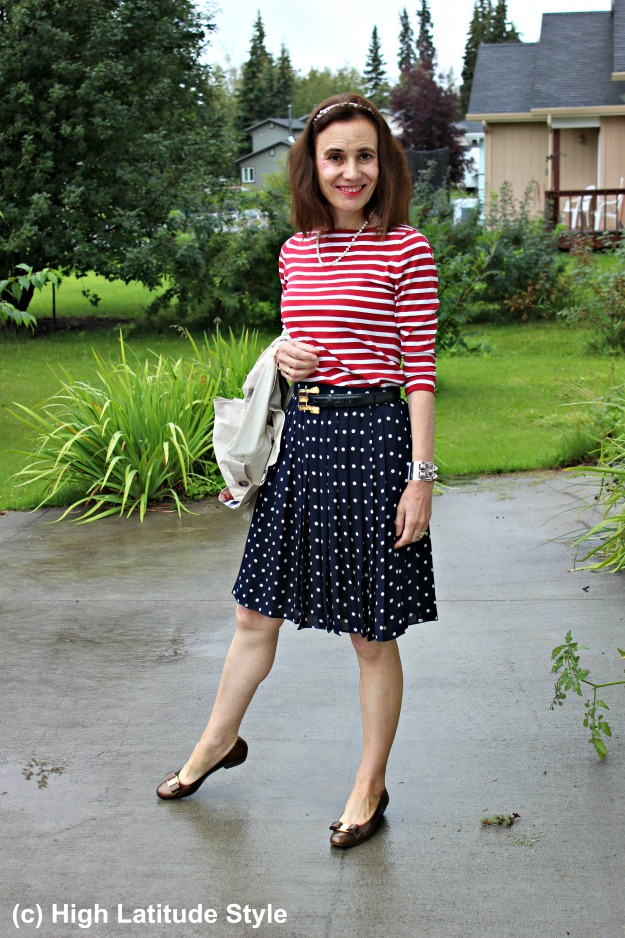 mature woman in polka dot skirt and striped top
