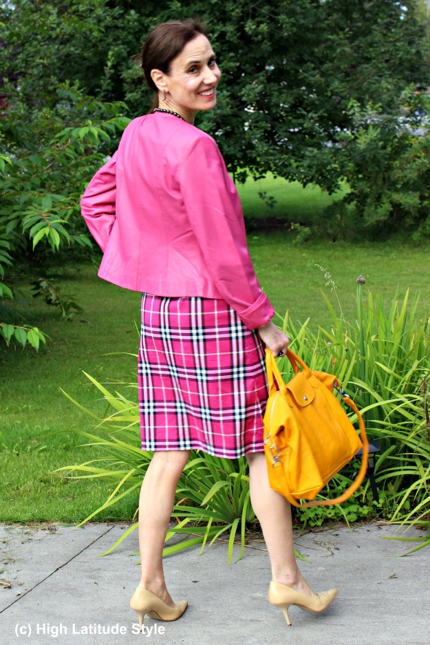 style blogger wearing a pink fake suit with yellow bag