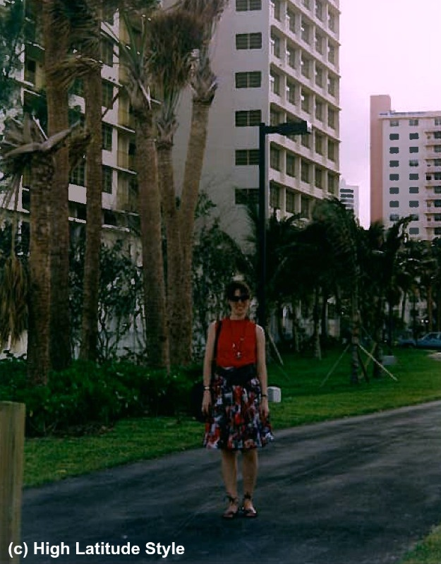 #vacationstyle woman in abstract print skirt and red top