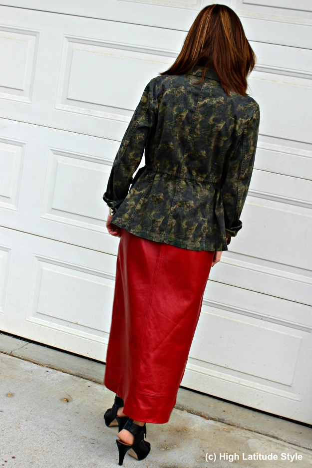 #fashionover50 woman in camouflage jacket with red leather skirt
