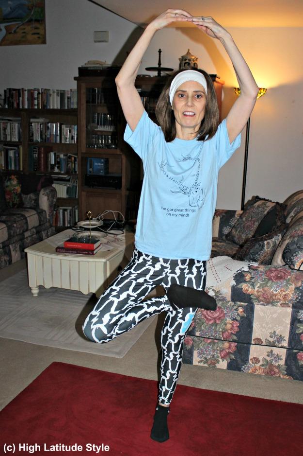 midlife woman doing exercises in Fishe Wear leggings